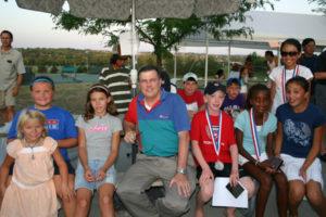 Mr. Gerdes with junior tennis players.
